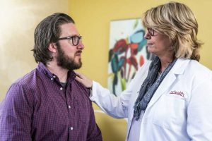 Doctor consulting with patient on cardiac electrophysiology page | UCHealth