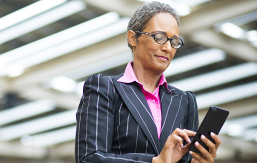 Woman executive using mobile phone