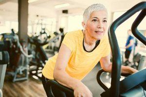 Woman on gym machine