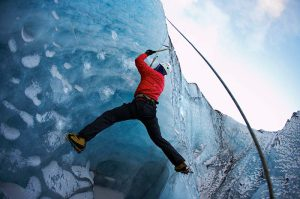 Ice climber on crevice wall