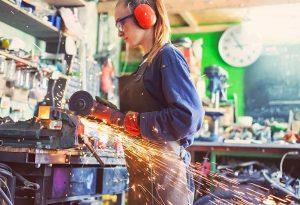 Woman working in machine shop