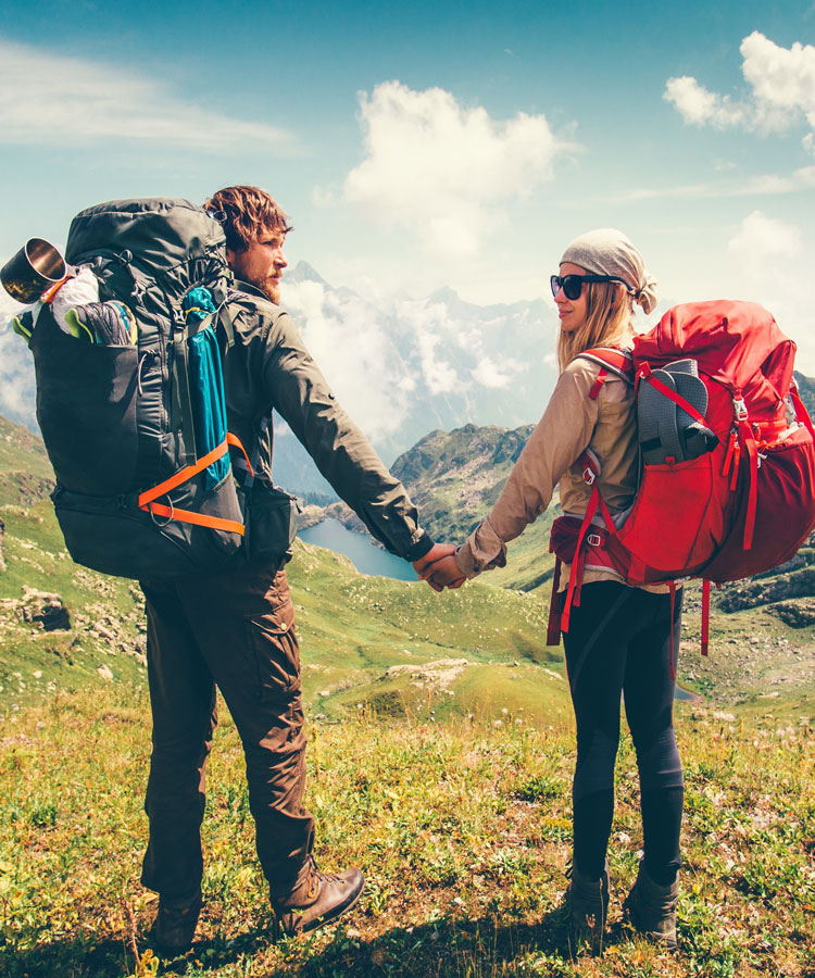 Woman and manhiking on path with packs