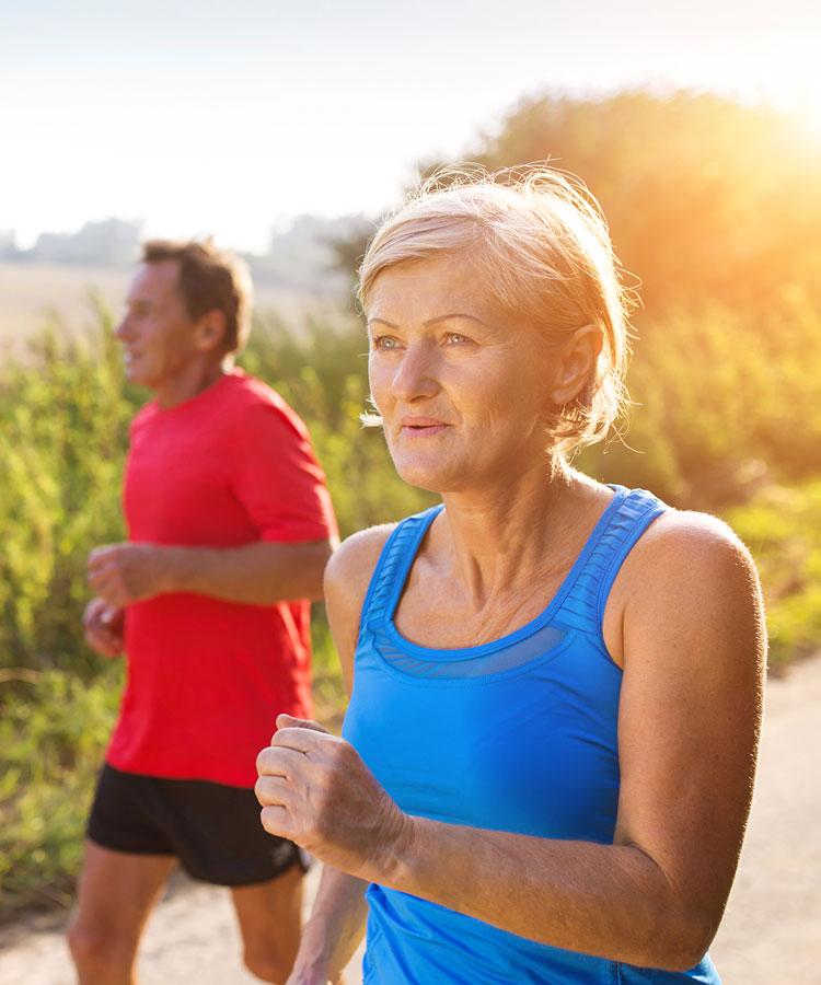 Mature couple jogging on path