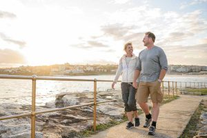 Couple strolling on a seaside walkway