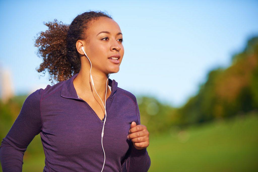 Women running while listening to music