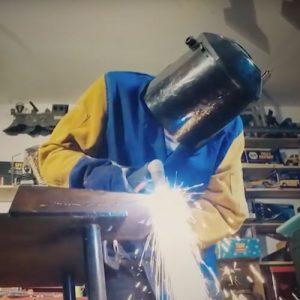 Man welding in a workshop