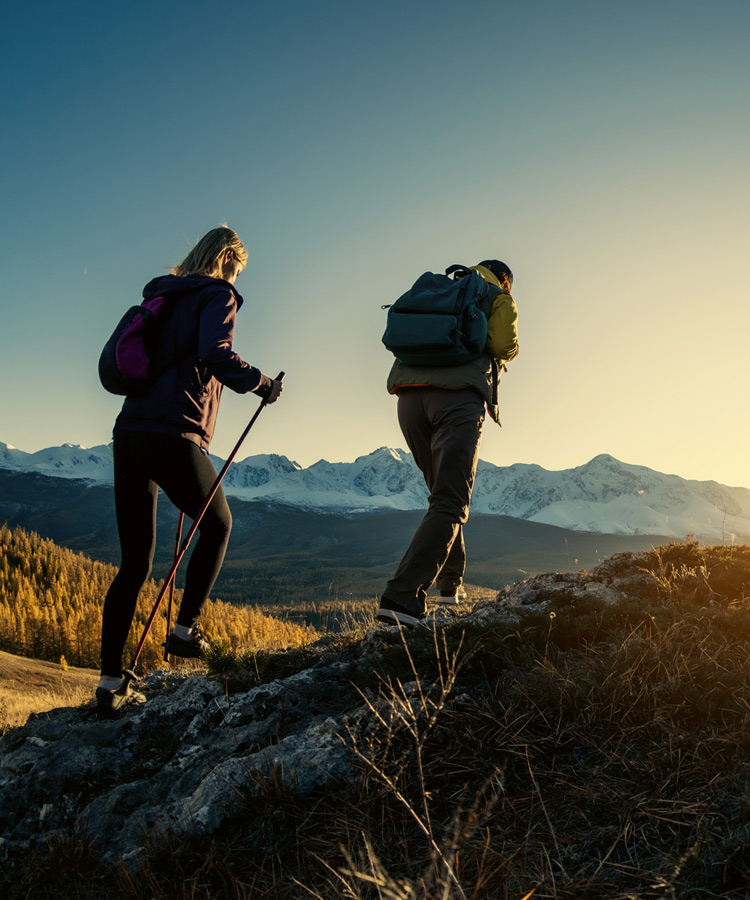Two hikers at sunset
