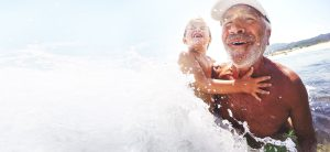 Grandfather and grandson in the water