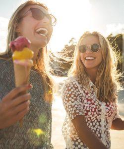 Girlfriends eating Ice Cream Cones