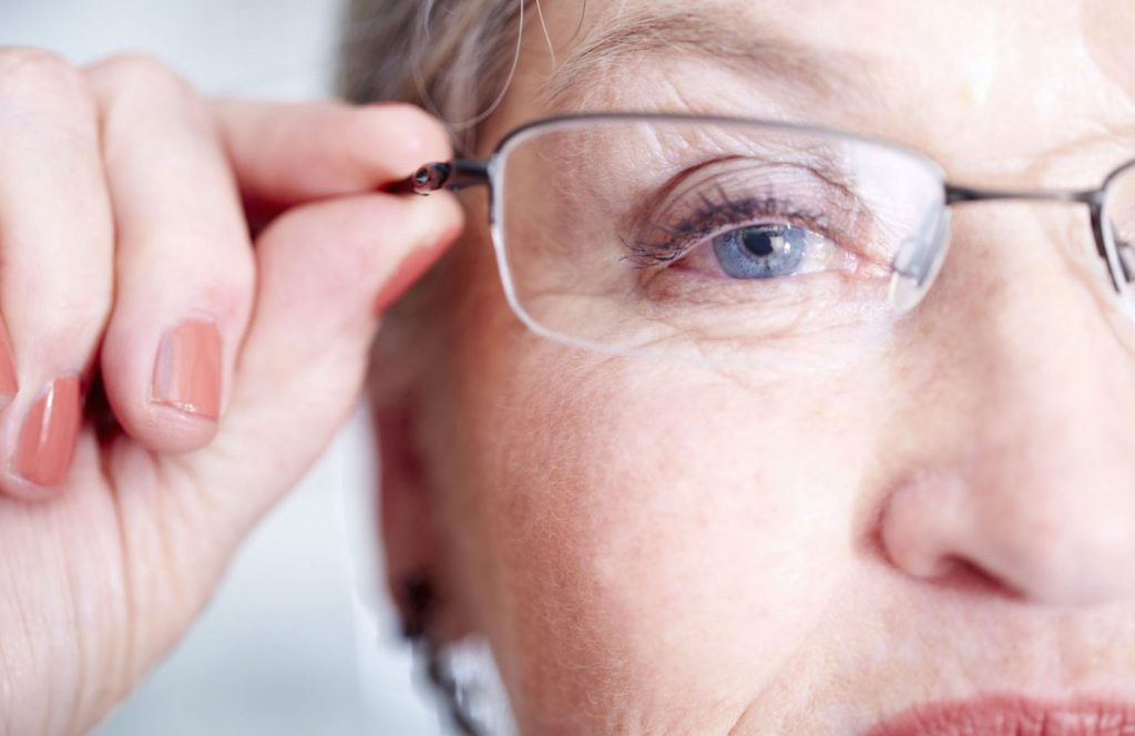 Close-up of woman wearing reading glasses