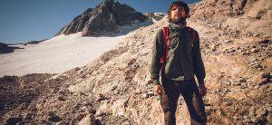Young man near summit of rocky peak