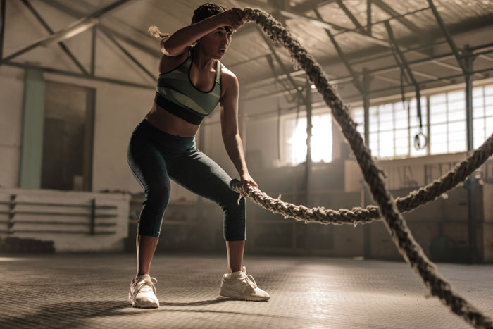woman in training working on ropes