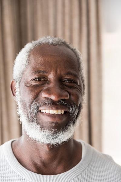 Man smiling in white shirt