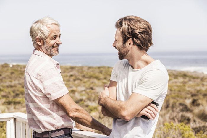 two men talking on a deck