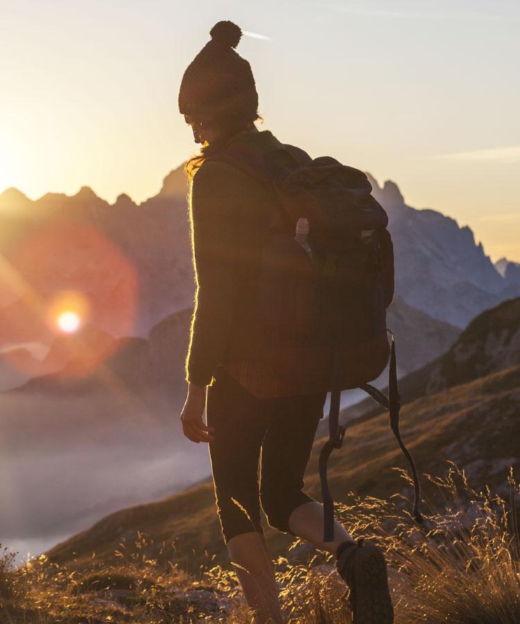 Woman hiking at sunset