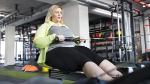 Woman on rowing machine at gym