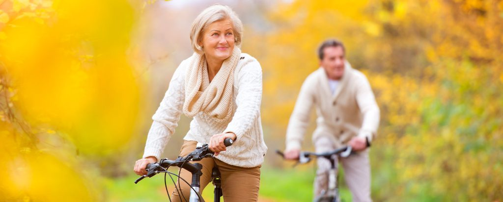 Lady and man riding bikes