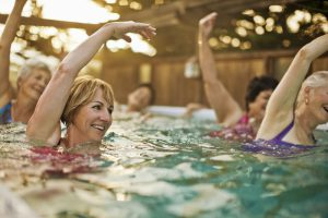 Woman in water exercise class