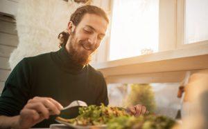 Young man enjoying a salad