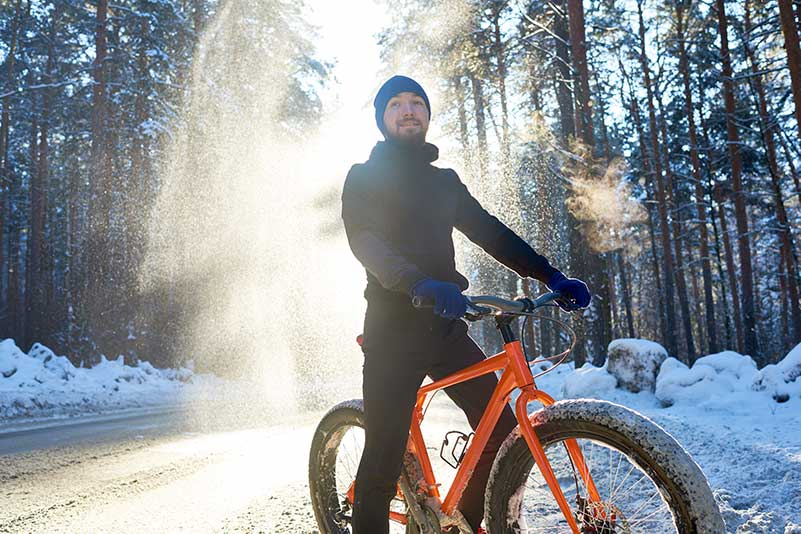 Fat tire rider on a snowy road