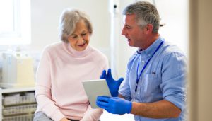 Woman and provider looking at tablet