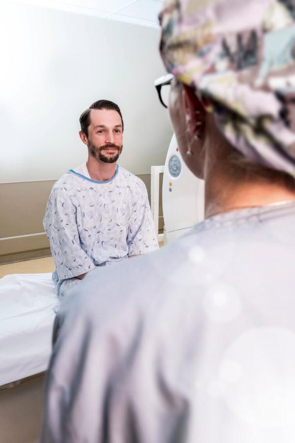 Patient listening to imaging technician
