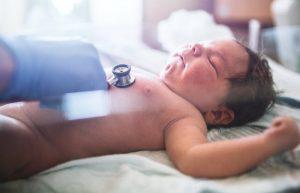 Newborn baby having heart checked