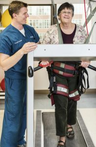 Rehab patient on treadmill with therapist