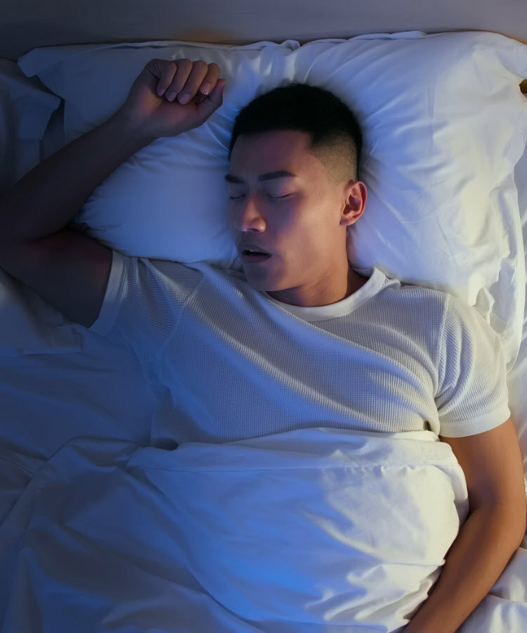 Young man sleeping on his back
