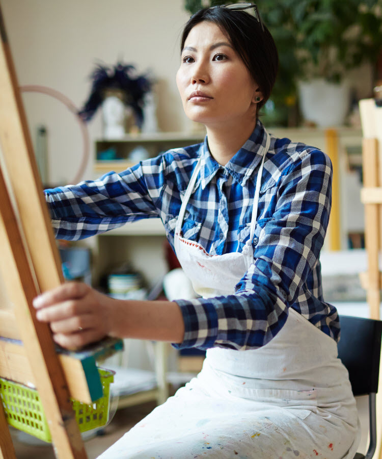 Asian woman in painting class