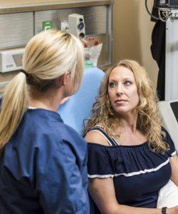 Woman looking at nurse in emergency room