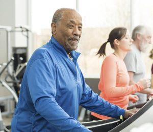 Older man exercising on treadmill