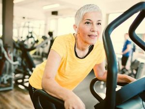 Woman exercising on gym machine