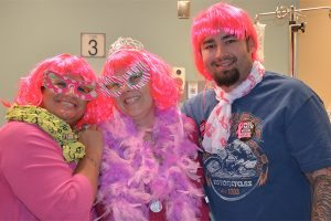 Jennifer Reid, Yvette Engel and Yvette's son, Josh, dress up in wigs and tutus to mark the end of chemotherapy for Yvette
