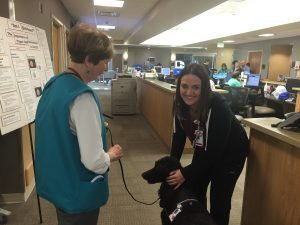 Surgical Intensive Care Unit nursing assistant Karley Beddoe gives Ebony a little love, and vice versa.
