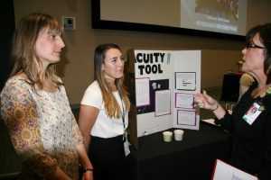 Maggie O'Connor (left) and Transplant Unit colleague Kelsey Christopoulos (center) with Carolyn Sanders.