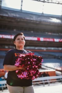 Carmen and the other survivors received pink pom poms to wave during their time on the field.