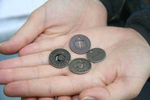 Music therapist Angela Wibben uses small coins to spark memories and reflections in patients.