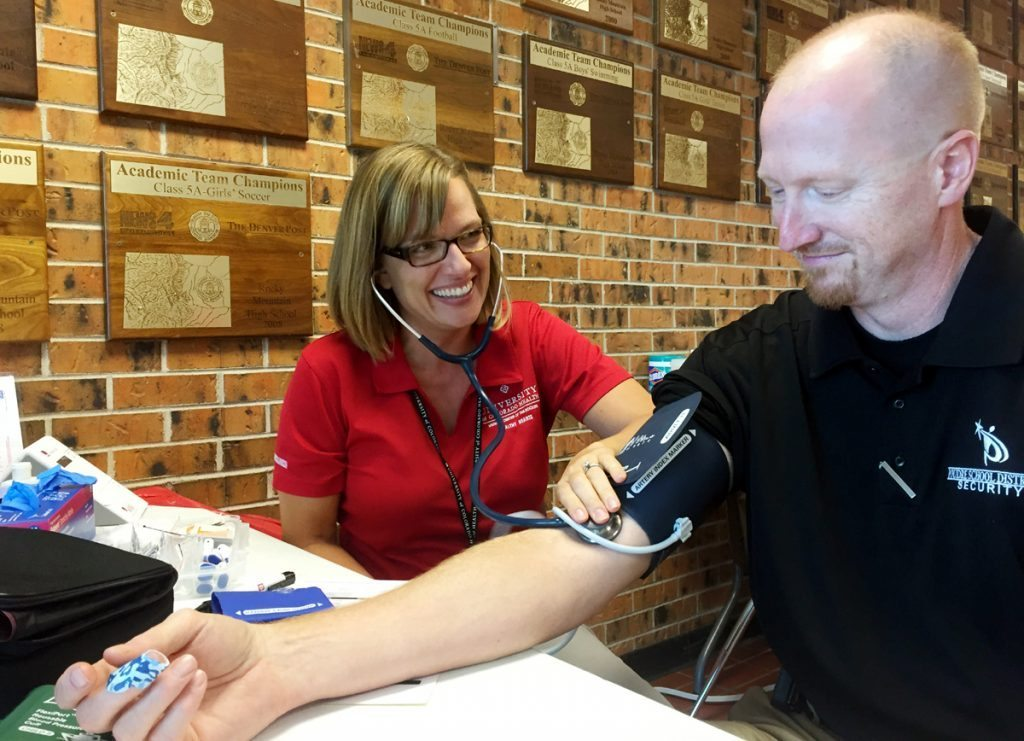 Melissa Armstrong, a health care screener with UCHealth's Healthy Hearts, screens an employee of Rocky Mountain High School in 2016. Healthy Hearts recently got a grant to be able to extend the screenings to employees of Thompson School District. Photo courtesy of Healthy Hearts.