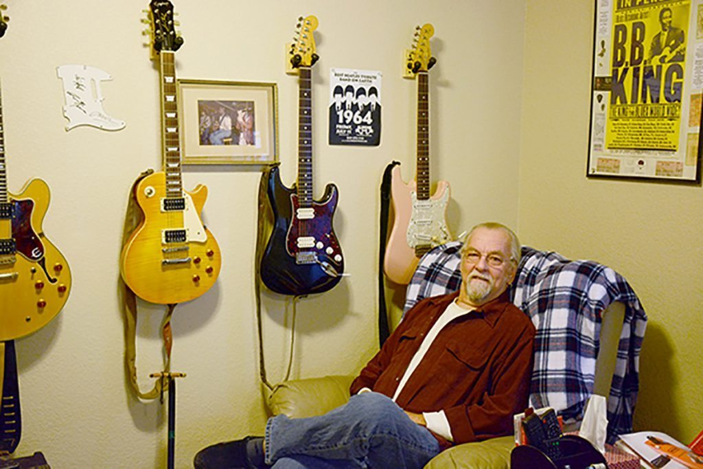"""Martin Gordon of the West Side Rhythm Kings in his """"man cave' with several guitars at his home in Colorado Springs."""