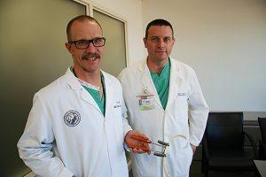 Dr. Erik Peltz and Dr. Robert Meguid pose for a photo.