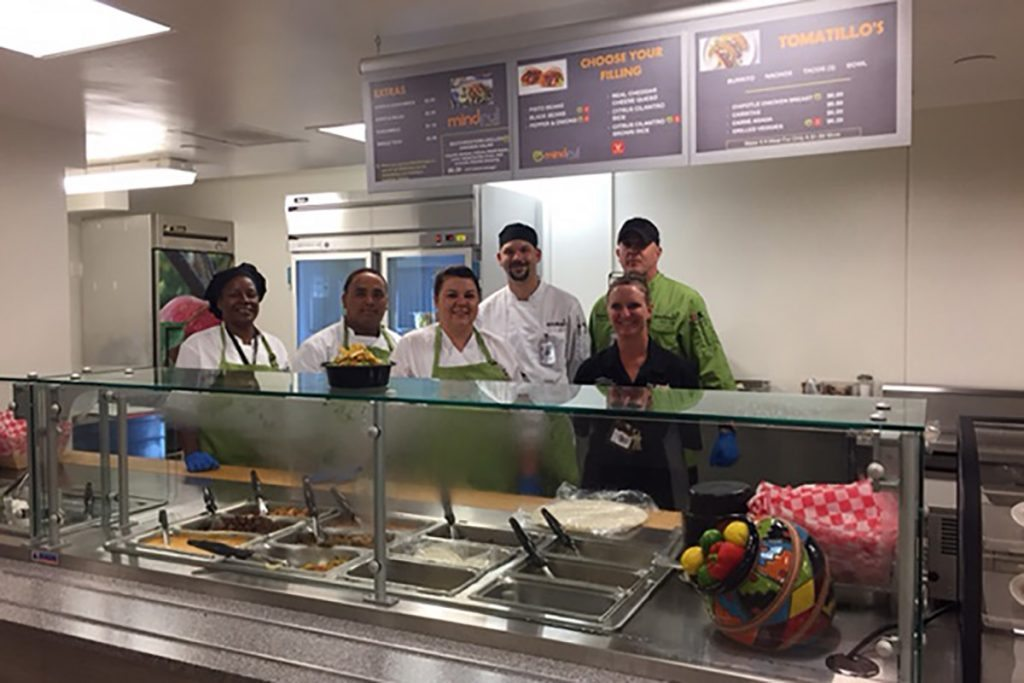 Members of Memorial's Food and Nutrition Services team, Odessa Charity, Domirick Arcega, Shalayna Manross, Mike Helmns, Rashell Kolthoff and Ben Patterson, are celebrating the opening of a newly remodeled kitchen.
