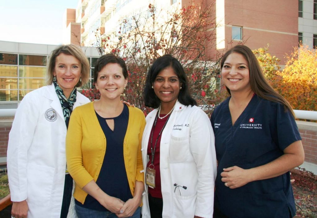 A patient pose with her oncology team.