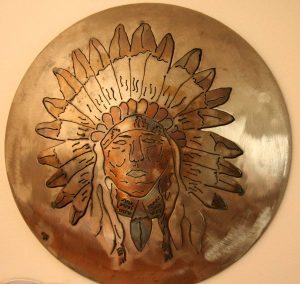 A patient's art includes Native American themes like this headdress.