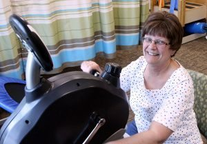 Deb Crites attends physical therapy at the Wellness Place at UCHealth Cancer Center in Fort Collins a few weeks after getting a shorter course of radiation therapy, made available to her through a clinical trial. Photo by Kati Blocker, UCHealth.