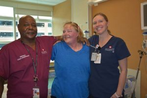 Kelley made a visit to her old room in the Burn/Trauma ICU Jan. 16. Left: Kelley with Rance Beasley, a burn technician, and Kelly Tuohy, charge nurse on the unit, both of whom cared for her during her 10-month stay at UCH.