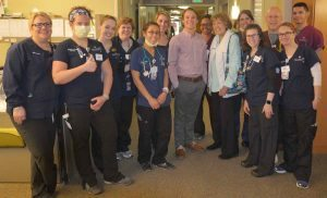 Kelly and Radke pose with some of the providers on the BMT Unit at UCH who helped to care for her.