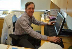 Greg Misky at his desk