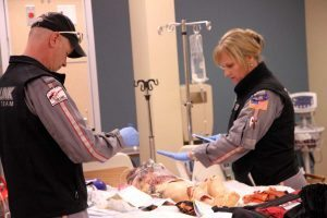 "Duane Rorie and Leanna Harpman, both certified flight registered nurses with the UCHealth Critical Care Transport team and Air Link of Medical Center of the Rockies, are shown working on a ""burn patient"" during a simulation training at the UCHealth Clinical Education and Innovation Center.."