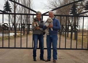 Jeanne and John Lambert are pictured with dogs Mollie and Ollie outside Colorado Youth Outdoors' Swift Ponds recreation center in Fort Collins.